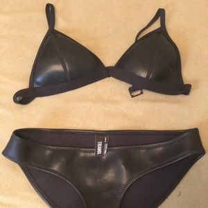 Triangl black on black bikini.
